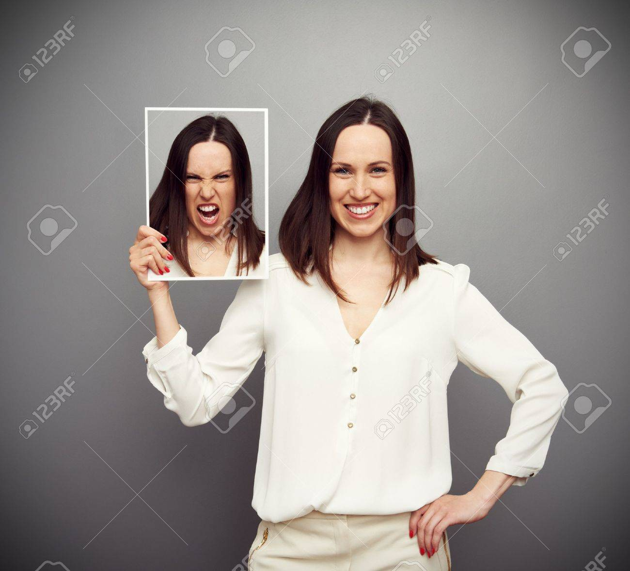 young smiley woman angry inside Stock Photo - 19062800