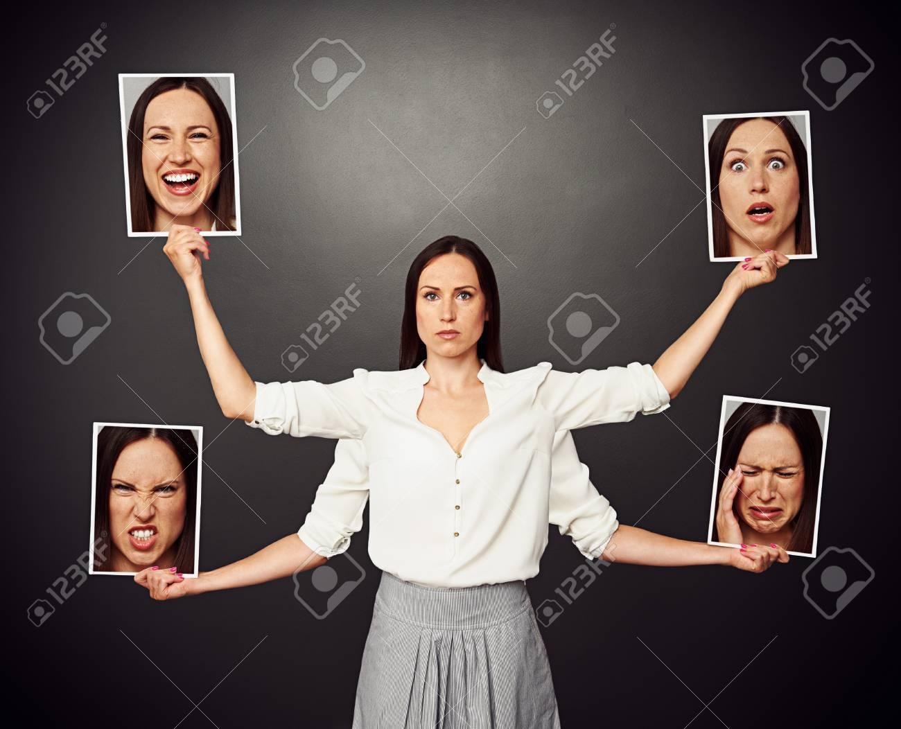 serious young woman holding pictures with different mood Stock Photo - 20019918