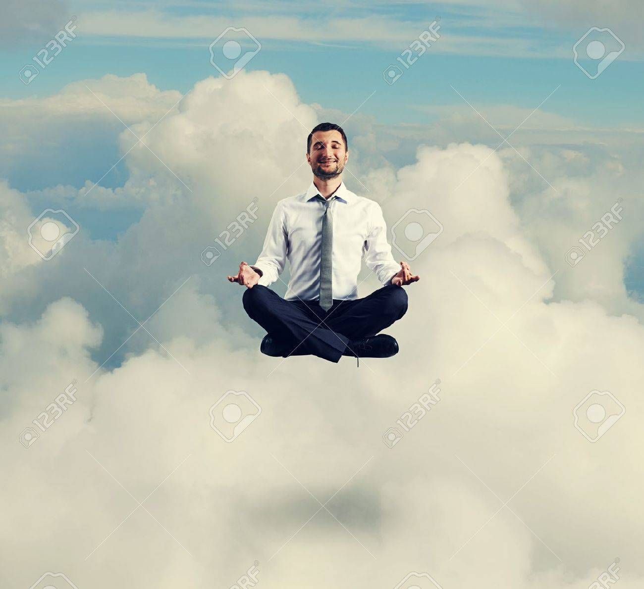 meditation businessman office. meditation man happy businessman in formal wear meditating the sky office