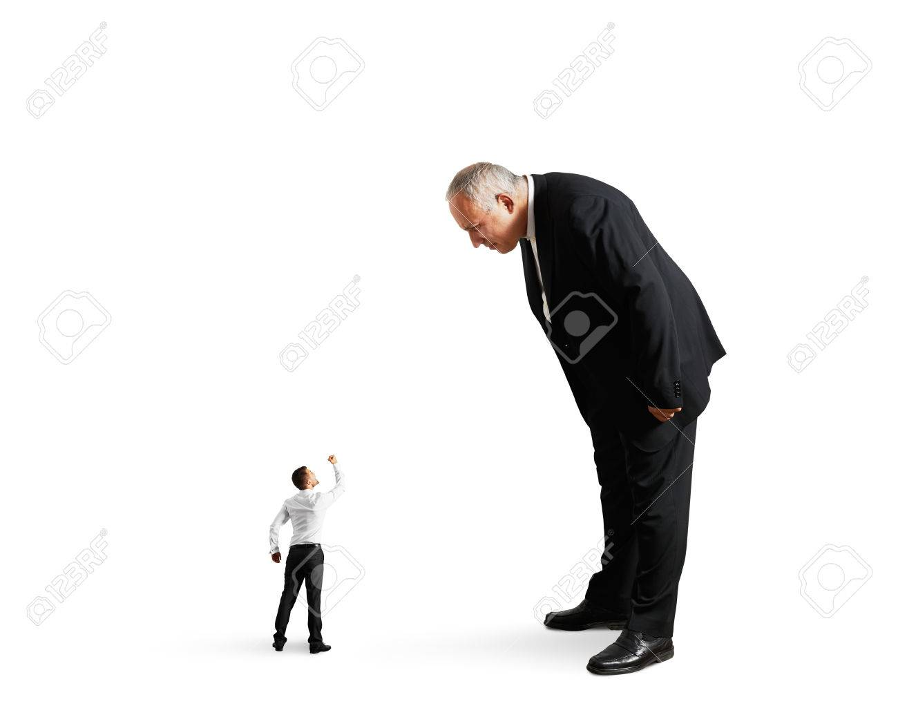 big boss good looking at small worker isolated on white stock photo big boss good looking at small worker isolated on white background