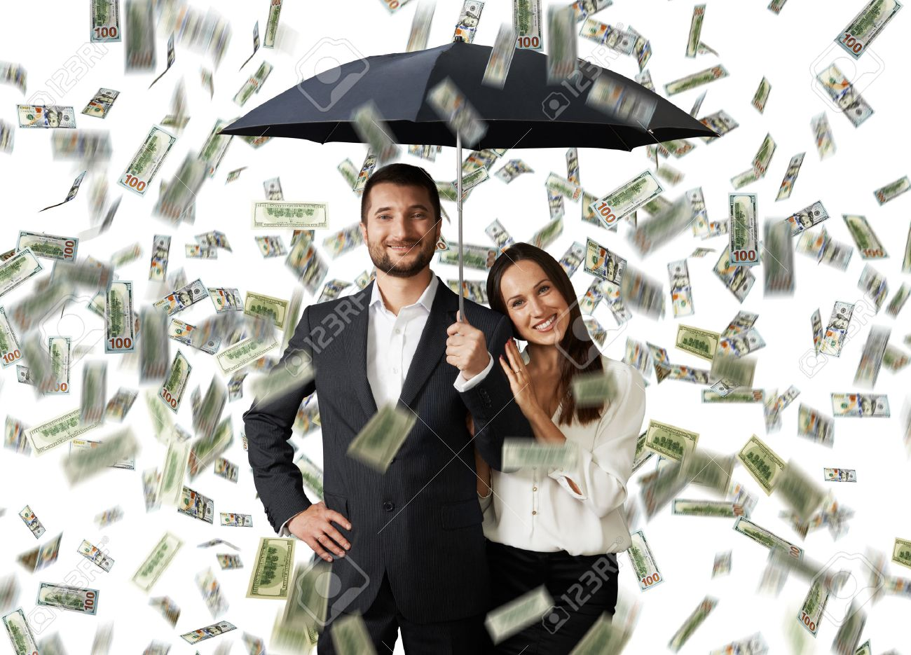 young smiley couple with black umbrella standing under money rain Stock Photo - 29781921