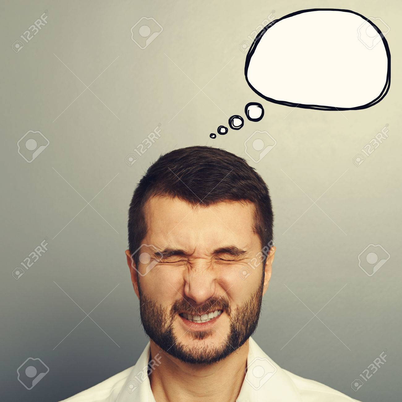 emotional man with drawing speech bubble over grey background Stock Photo - 30834581