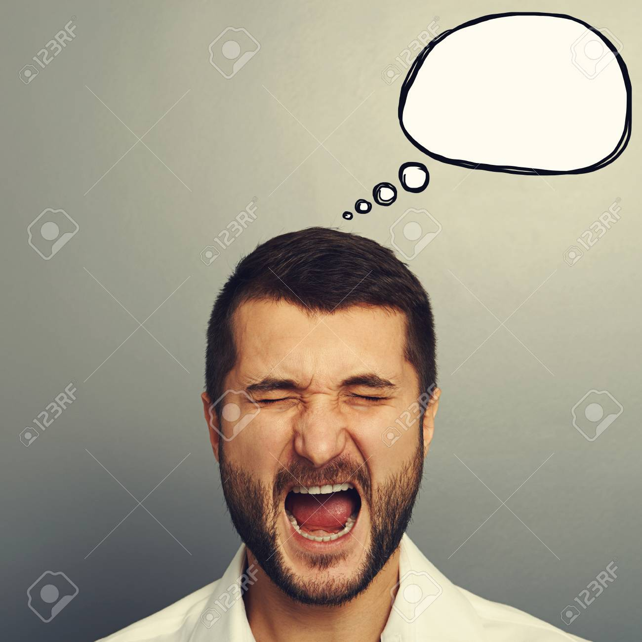 portrait of screaming man with empty speech bubble over grey background Stock Photo - 30834584