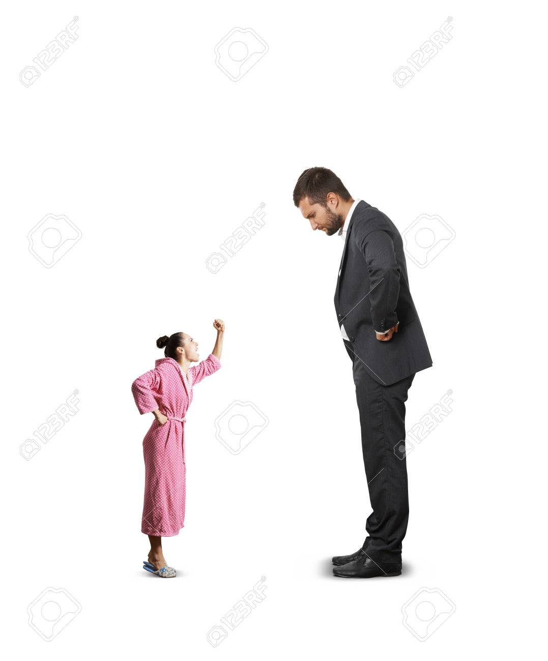 Dissatisfied Man In Black Suit Looking At Small Angry Woman In ...