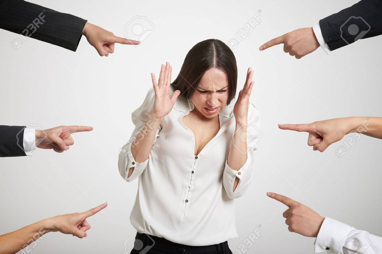 Many Fingers Pointing At Stressed Businesswoman Over Light Grey.. Stock  Photo, Picture And Royalty Free Image. Image 39631998.