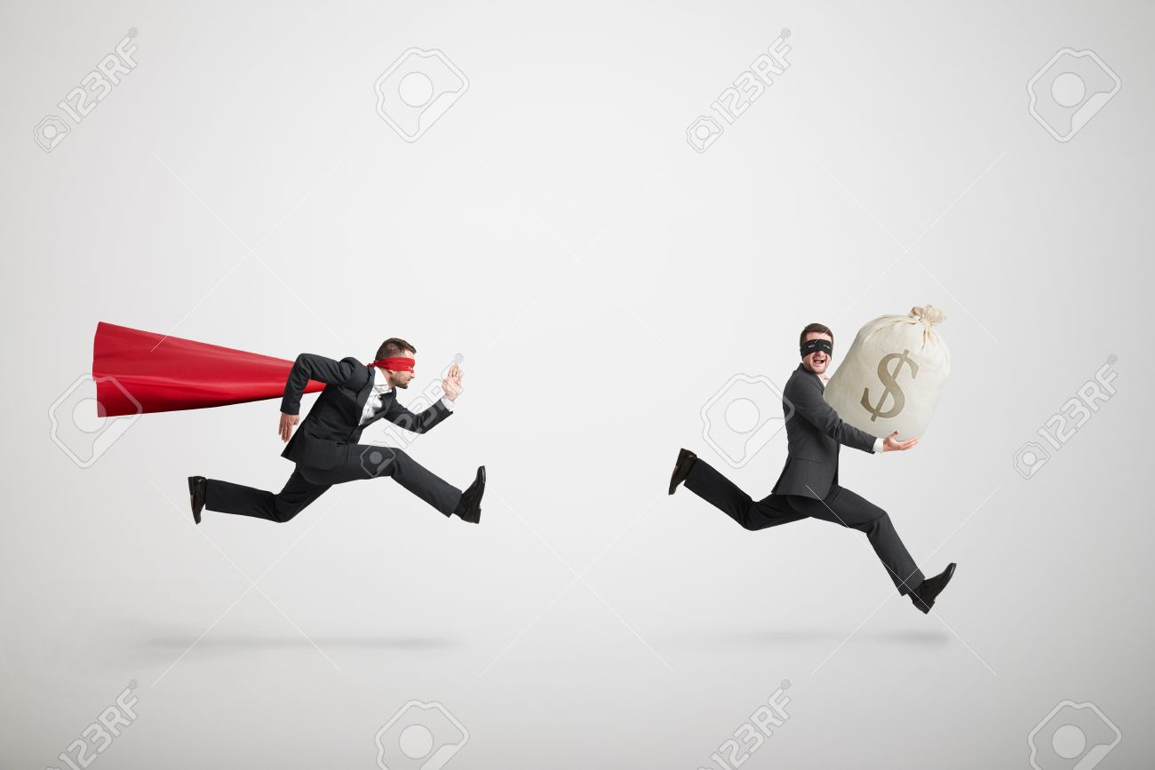 thief stole the bag with money and running away from superman over light grey background - 39632107