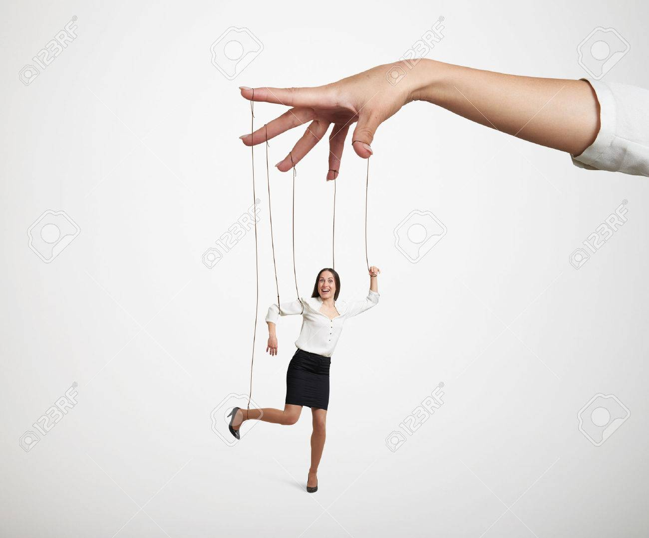 womans hand manipulating the small puppet over light grey background - 40300754