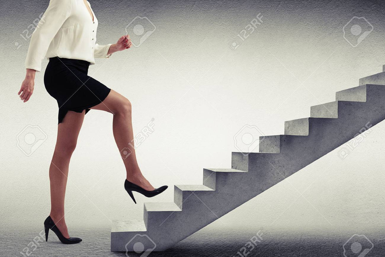 to climb up the ladder images stock pictures royalty to to climb up the ladder businessw in formal wear walking up stairs over light grey