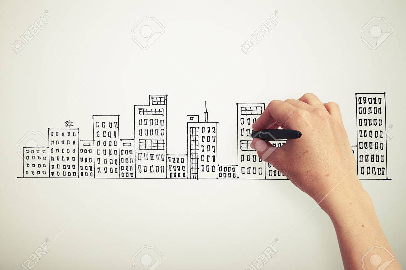 womans hand drawing cityscape on white paper stock photo picture
