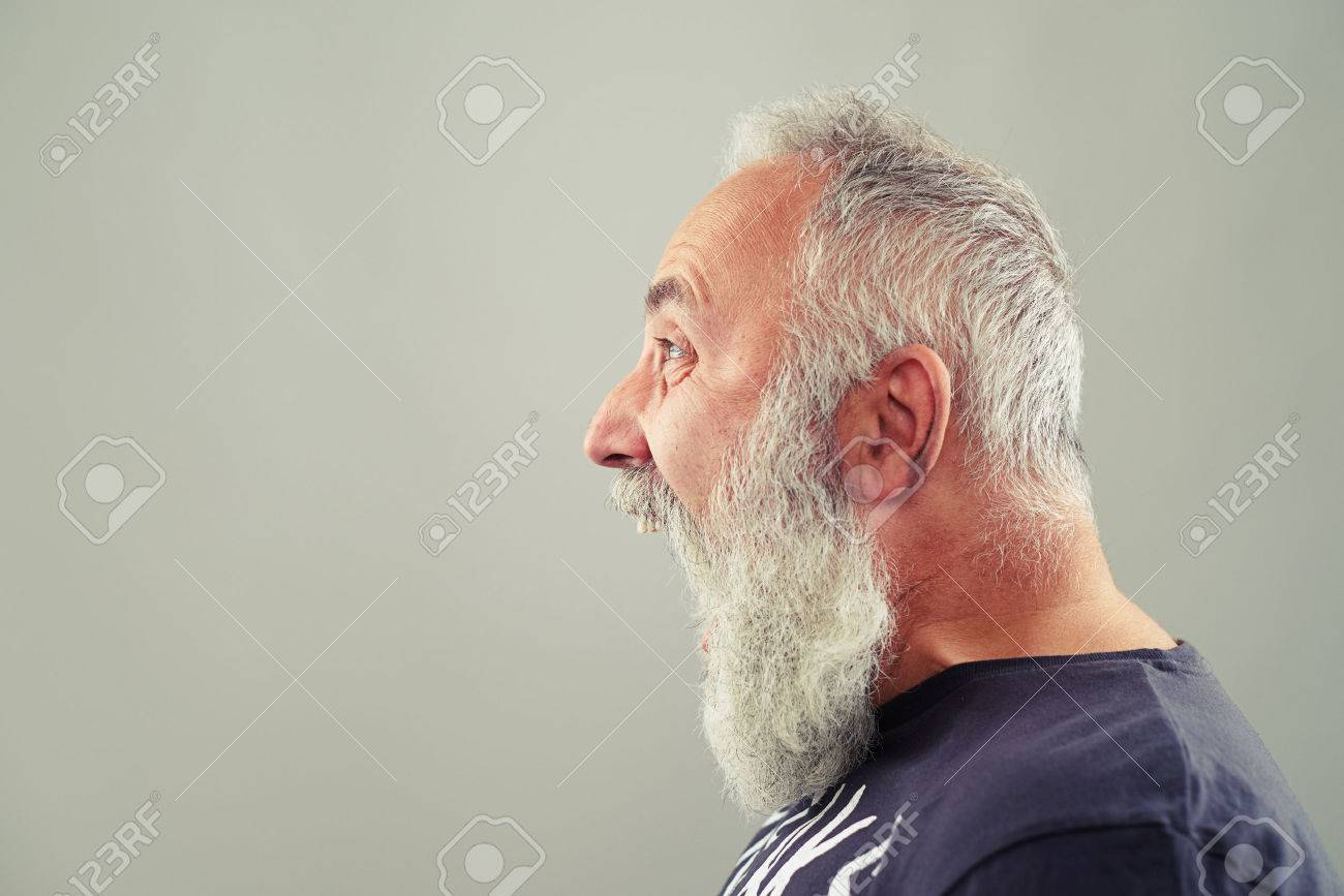 sideview portrait of screaming senior man with grey-haired beard - 47170275