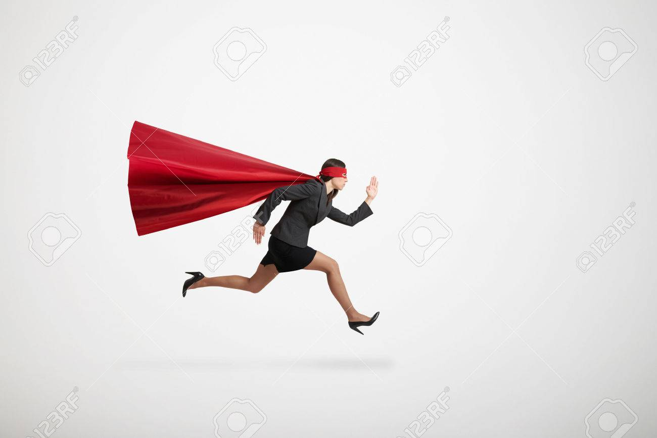 serious businesswoman wearing like superhero very fast running over light grey background - 49452696