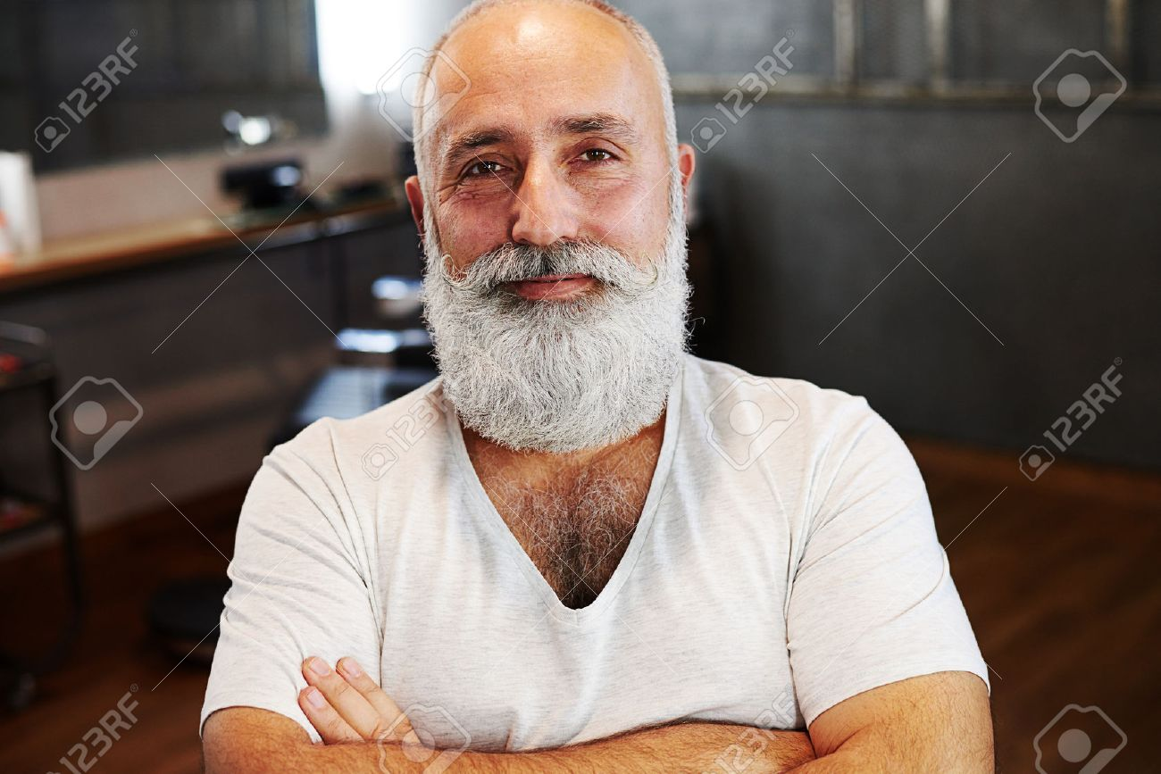 portrait of smiley senior man with beard and moustache - 52481331