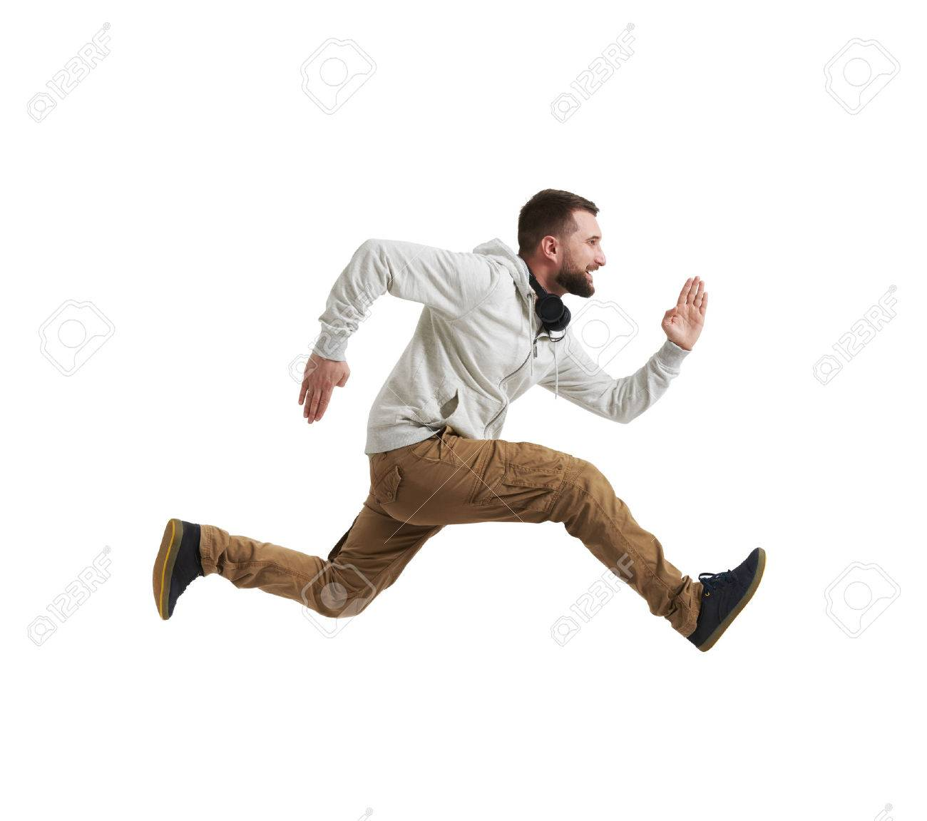Young bearded man in casual clothes is shot in mid-air jump isolated over white background - 60221779