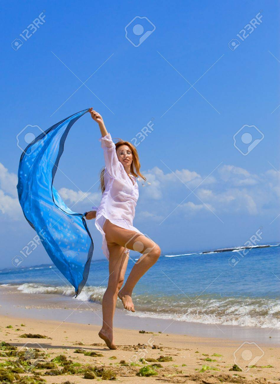 The young beautiful woman on an ocean coast. Indonesia. Bali. Stock Photo - 8147478