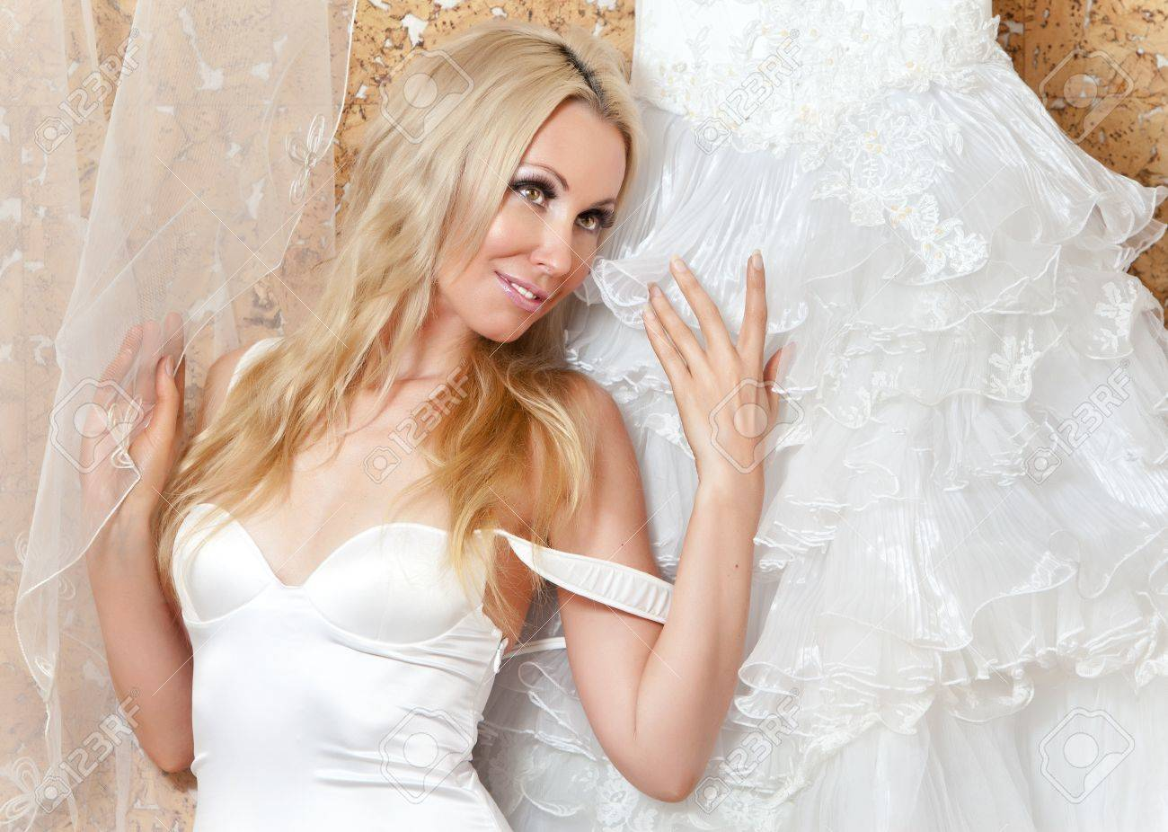 The happy bride tries on a wedding dress Stock Photo - 9751118