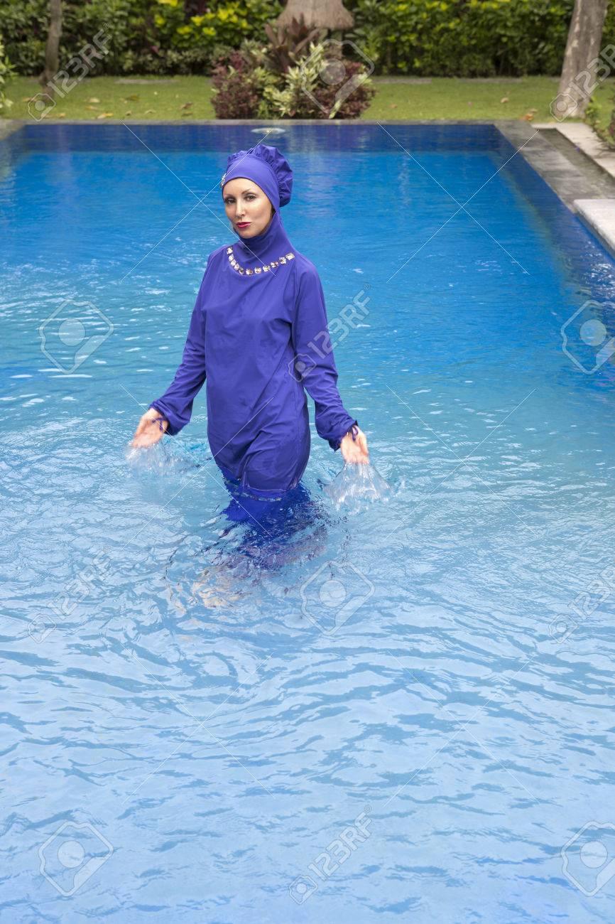 f18b04bc50b attractive woman in a Muslim swimwear burkini in the pool