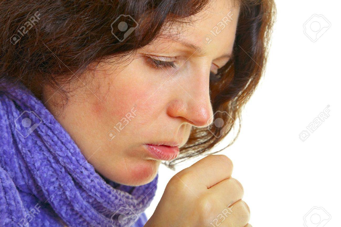 Young woman with brown hair has a flu, isolated on white background, studio shot. Stock Photo - 14334892