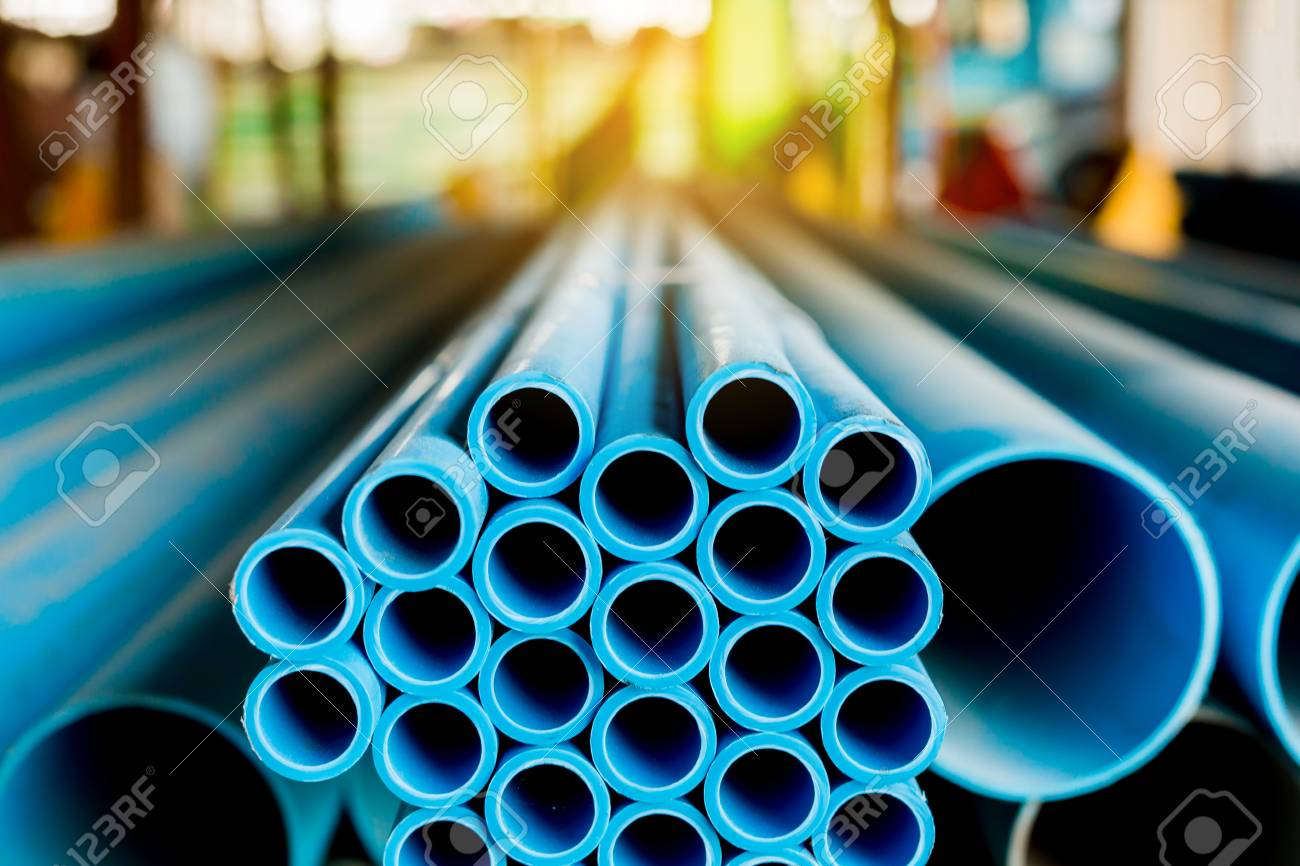 Close up to blue plastic pipe background, PVC pipes stacked in