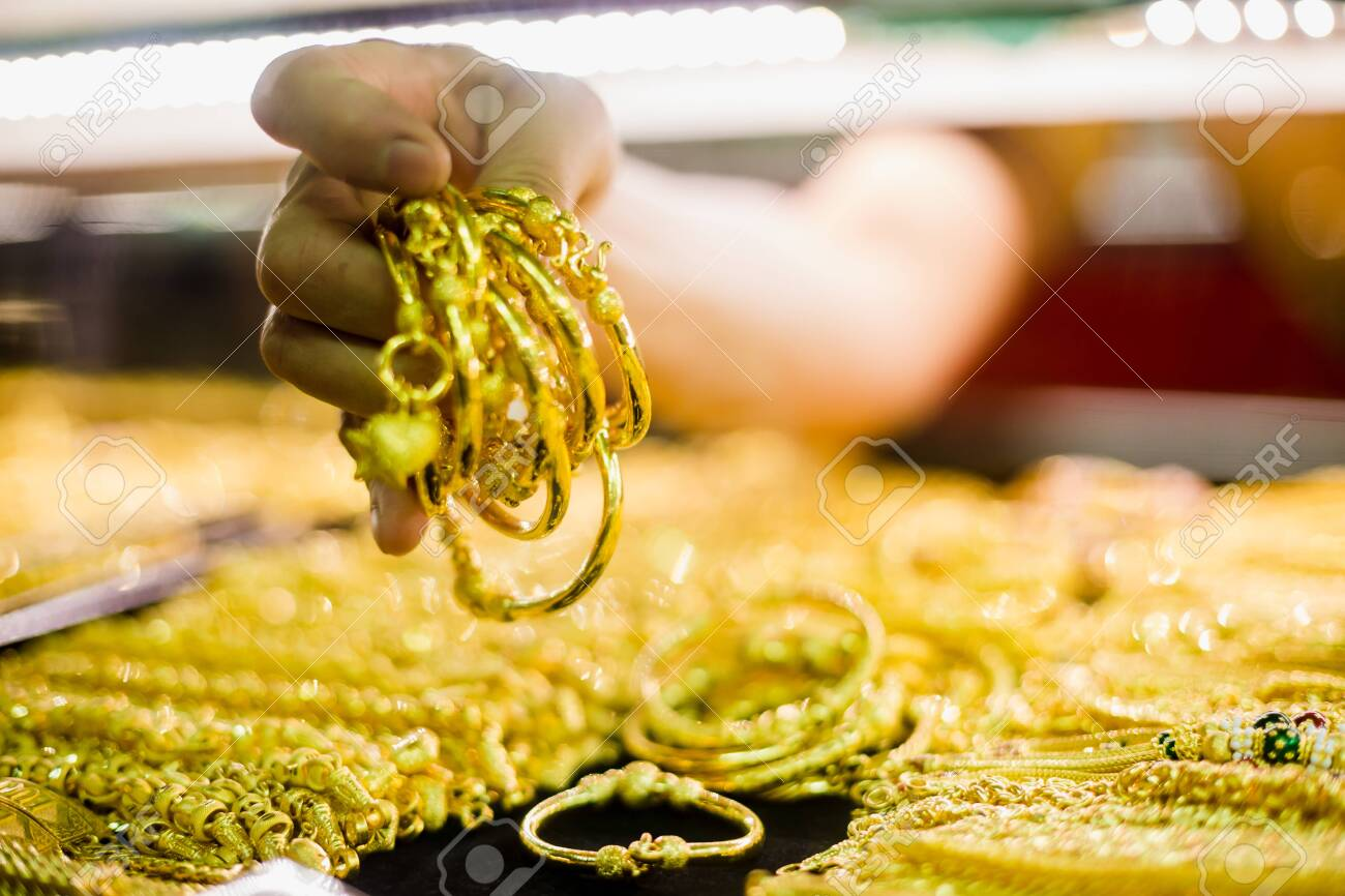 Selective Focus To Hand Holding Gold Jewelry, Customers Are Buying.. Stock  Photo, Picture And Royalty Free Image. Image 125677418.