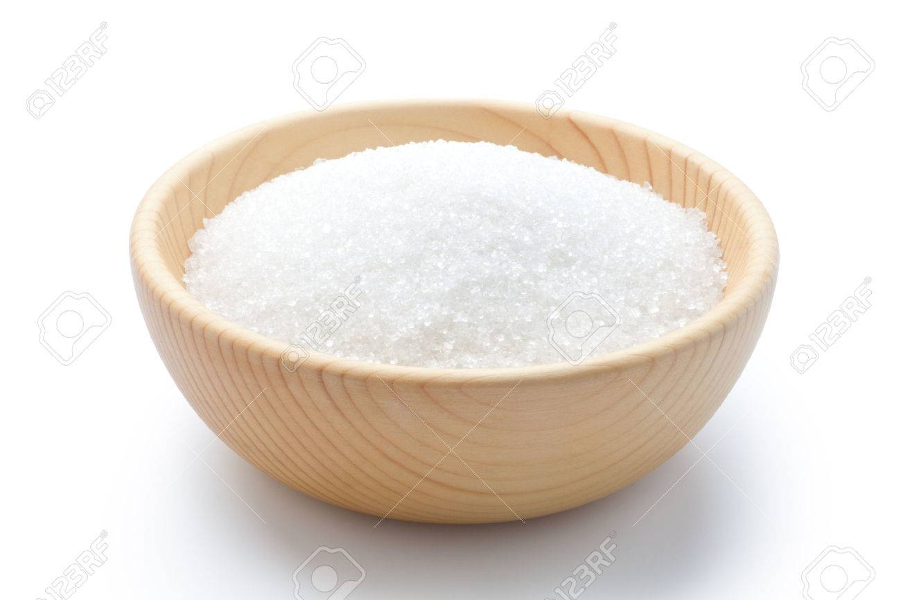 white sugar in a wooden bowl stock photo