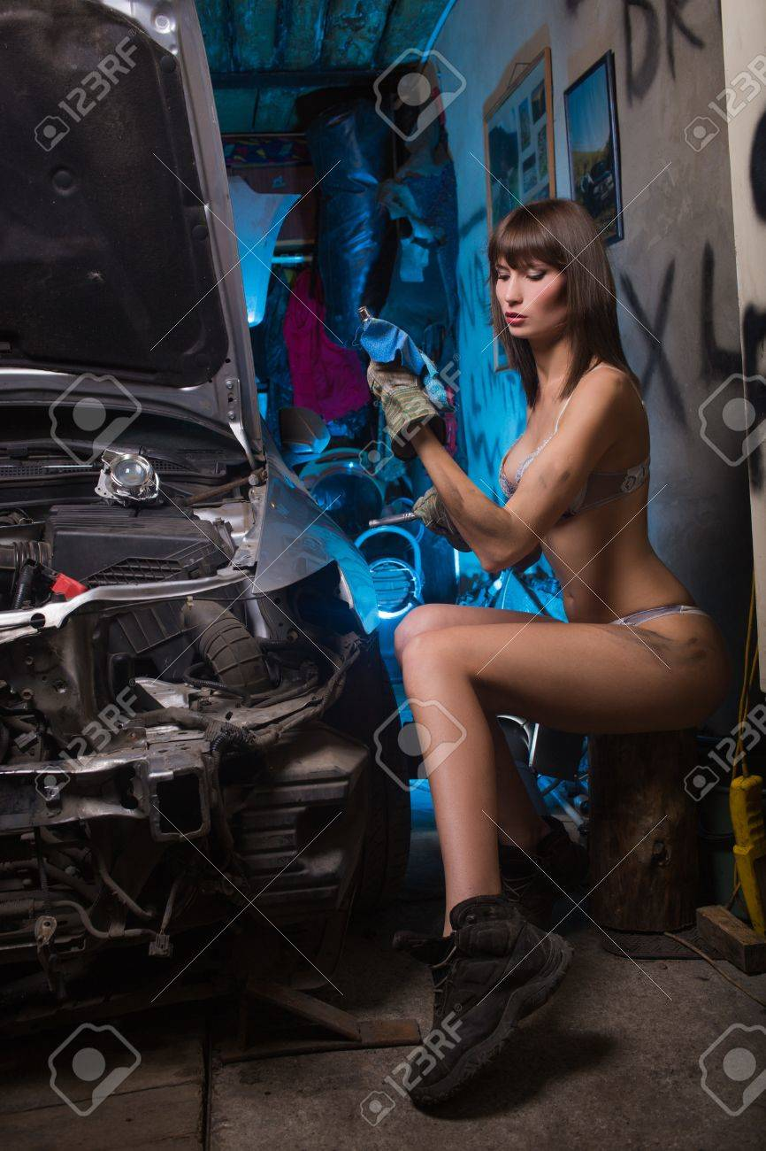 Girl in the garage with the tools in heavy boots and underwear - 25607772