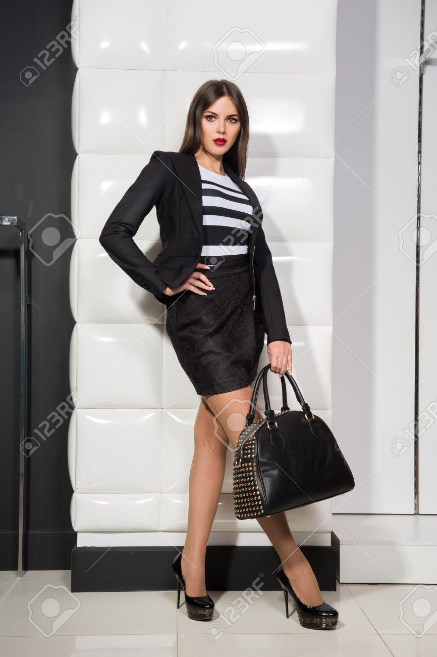 stylish girl with a bag - 30024416