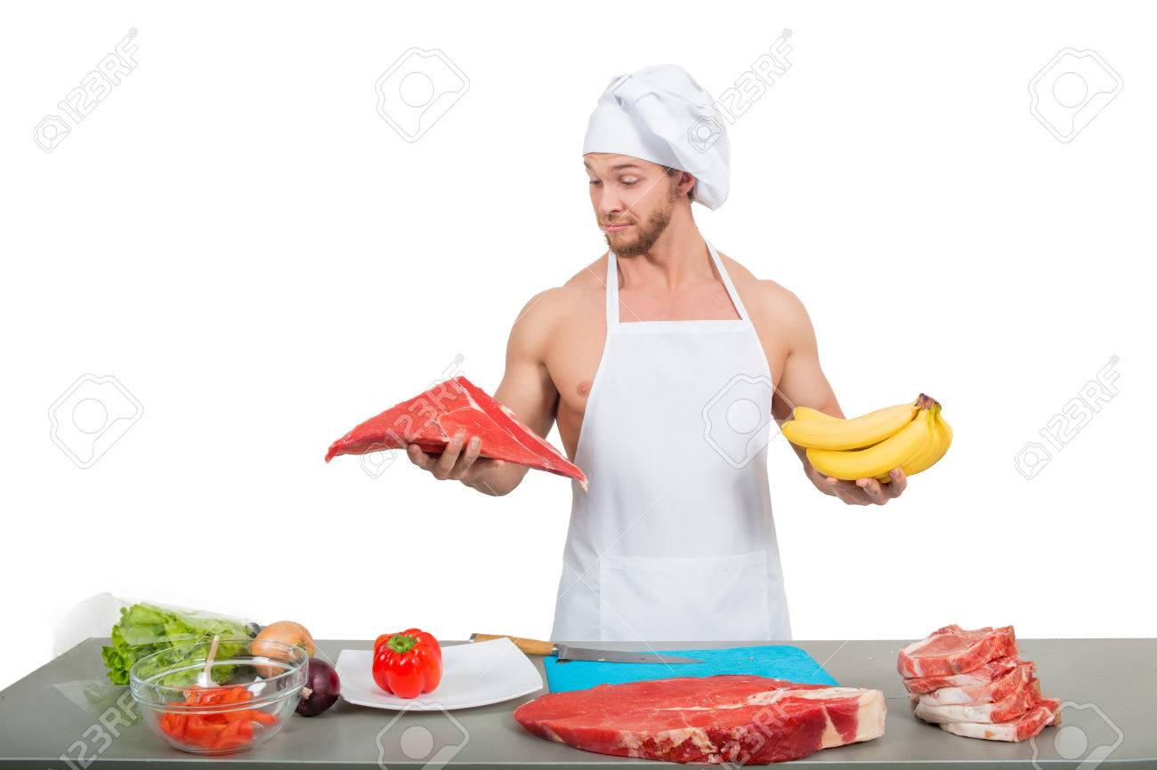 White apron meats - Stock Photo Chef In A White Apron Holding Meat And Bananas
