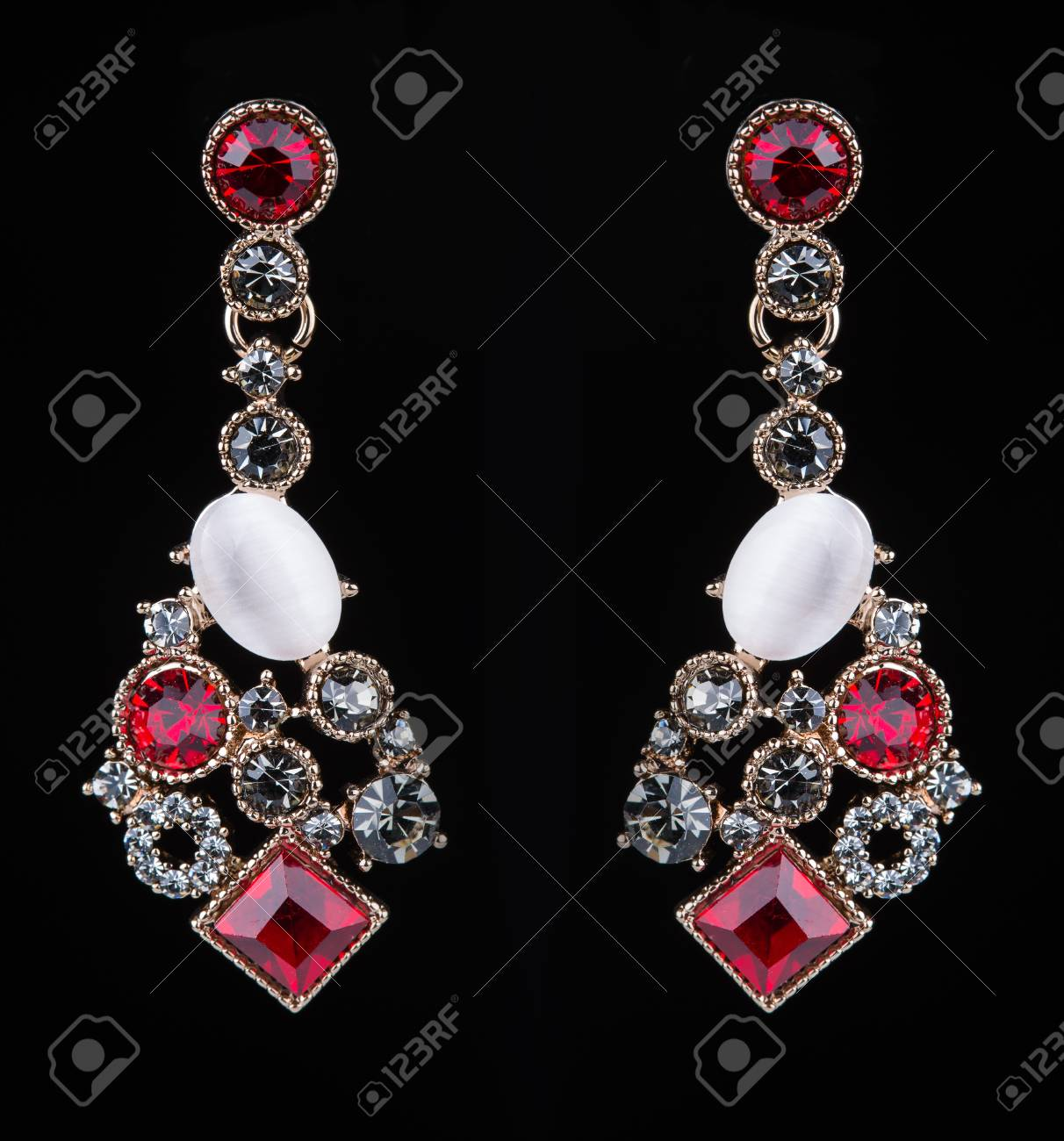 Beautiful Earring With Colorful Red Gems On Black Background Stock ...