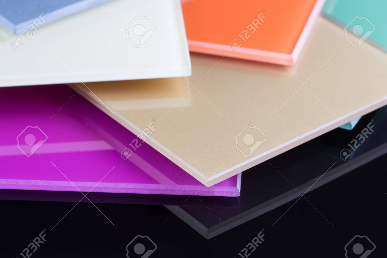 a stack of colored glass on a black background design glass sheets stock photo - Colored Glass Sheets