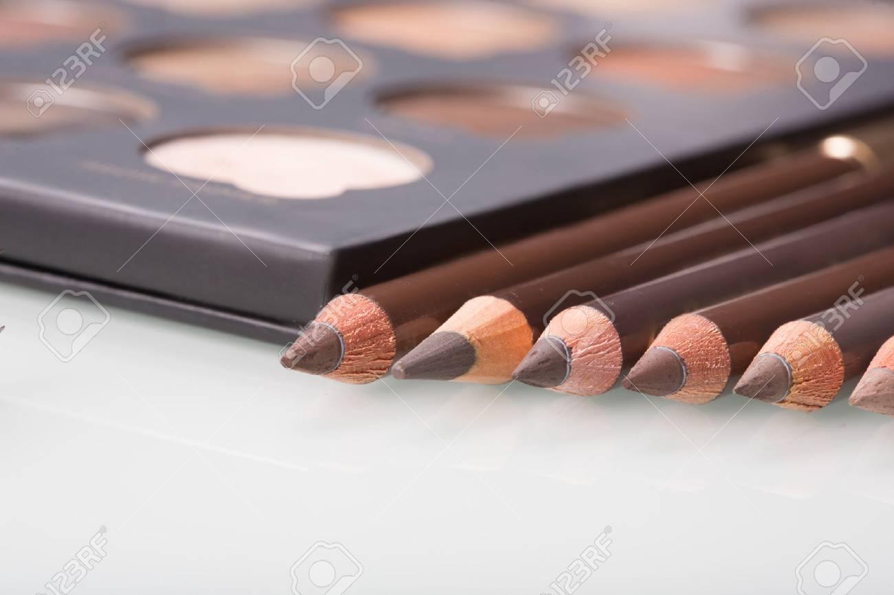 shadows eye and eyebrow set on table. eyebrow pencils - 43777959