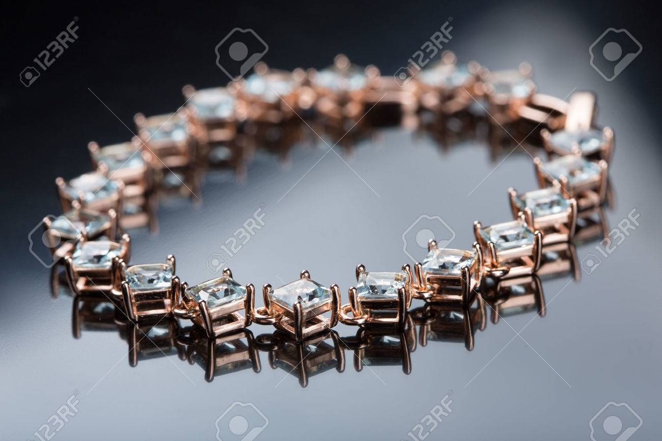 Jewelry diamond bracelet on a gray background - 45594071