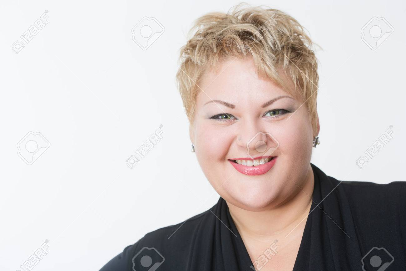 Smiling fat woman in black dress. light background - 46289435