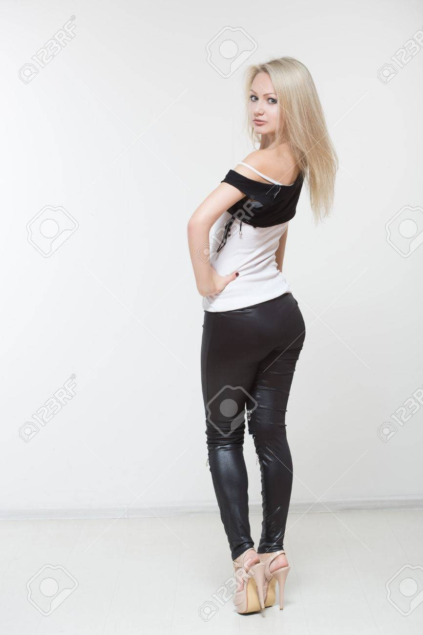 24f049822 Beautiful girl in black leather pants. on a white Stock Photo - 46703245