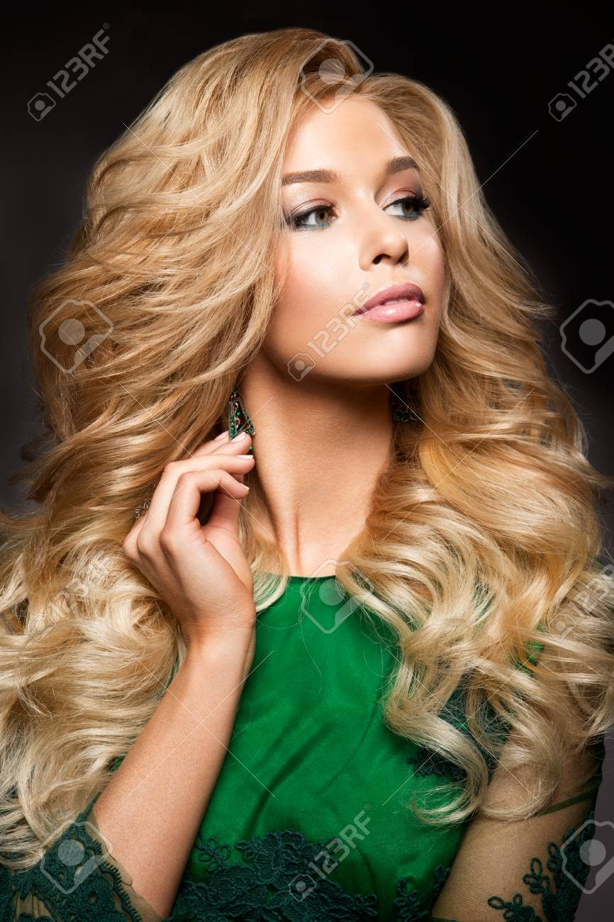 Portrait Of Elegant Sexy Blonde Woman With Long Curly Hair And