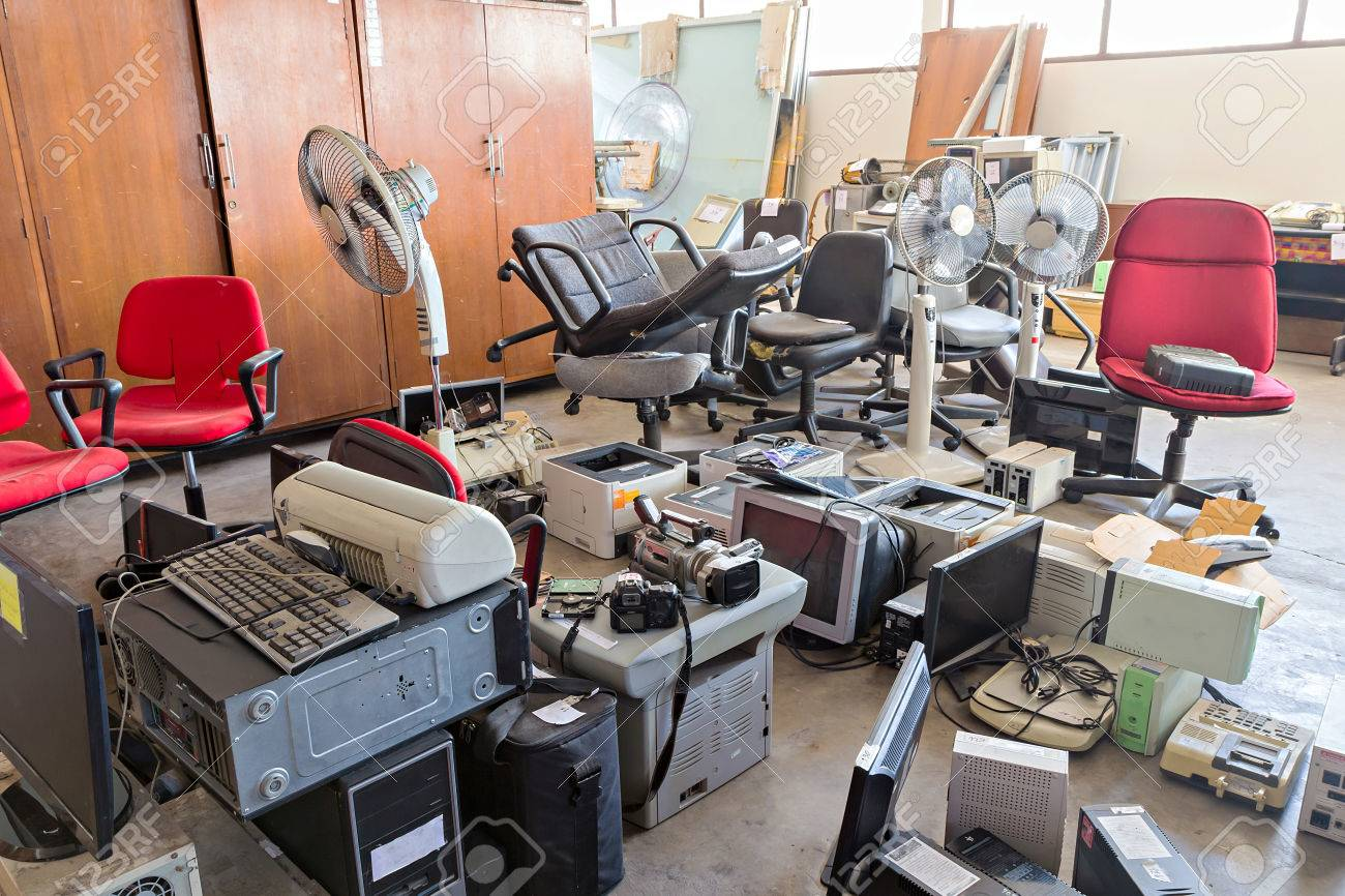 Broken Office Chairs And Electronic Waste In The Store Room Stock ...