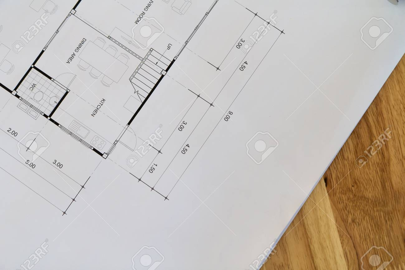 Top view of an architectural blueprint with black and white details stock photo top view of an architectural blueprint with black and white details on architect desk malvernweather Images