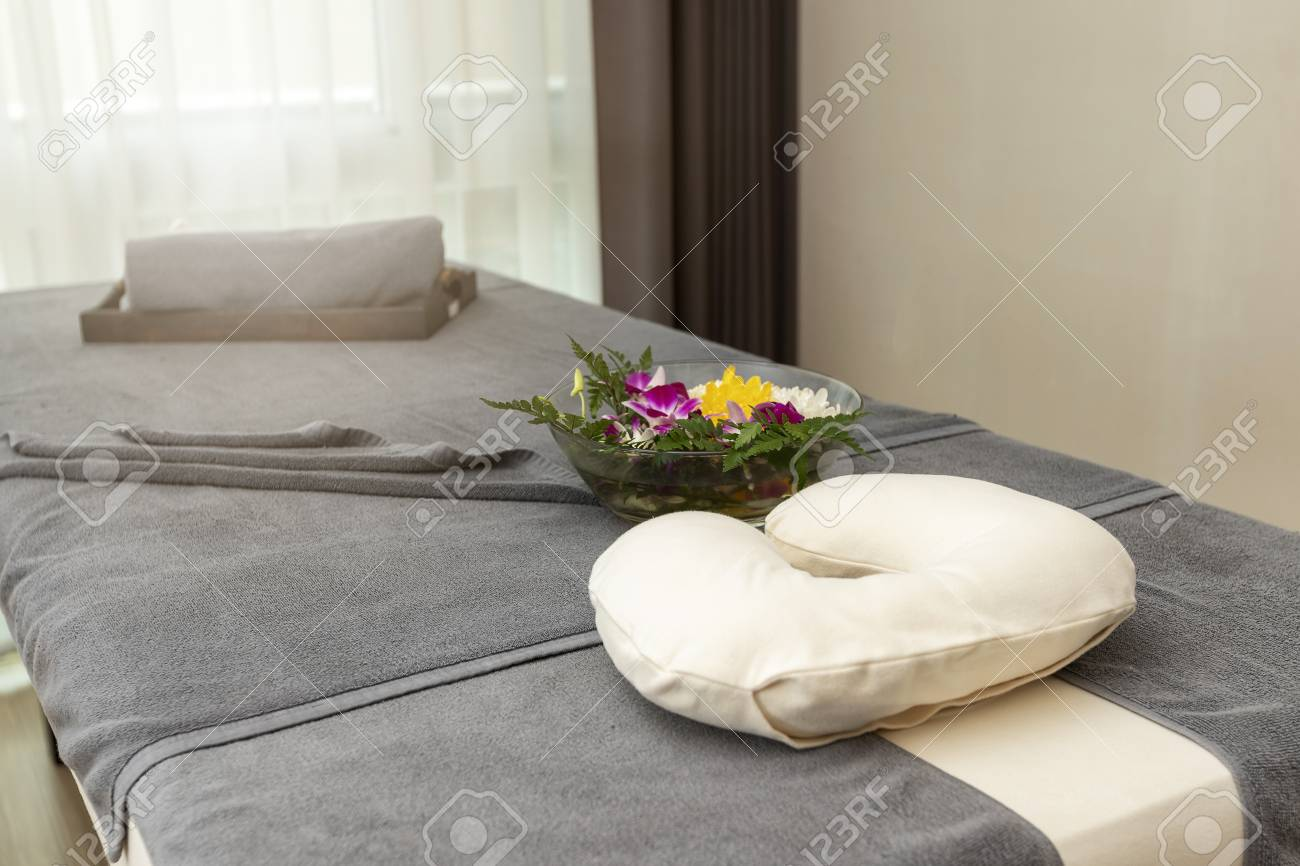 Pillow With Towel And Flower On Massage Table In Modern Spa Salon ...