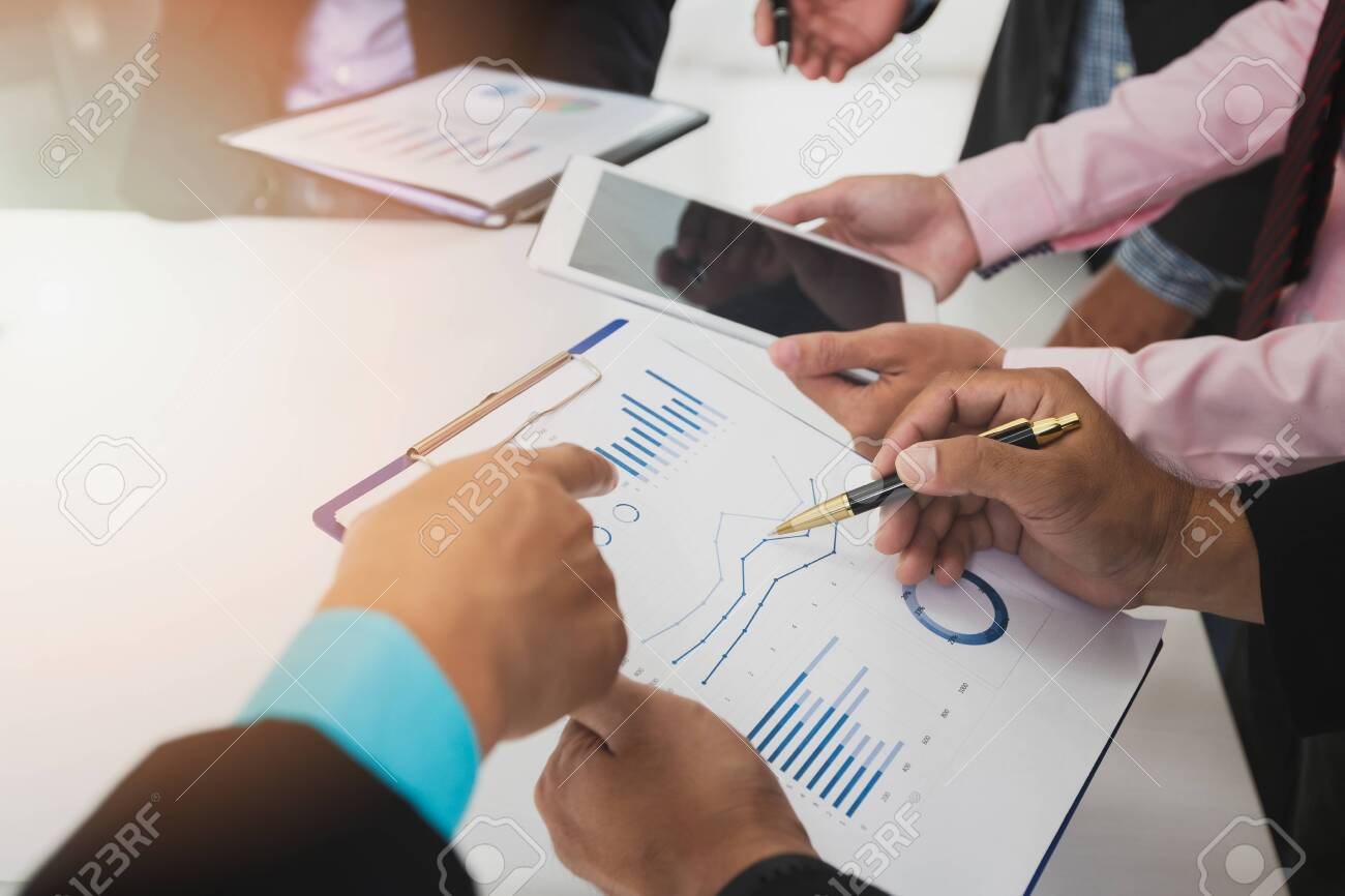 Businessmen discussing together in meeting room. Business team meeting and discussing project plan. Professional investor working with business project together. Finance managers task. - 126136262