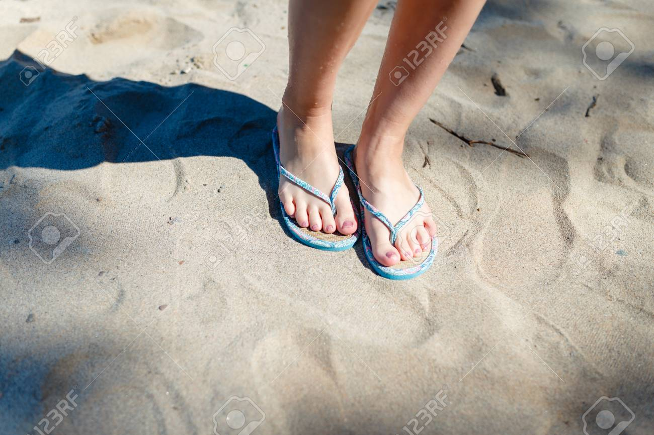 fbfd680004b3cb Feet Girl with a neat pedicure in women s stylish beach flip-flops aqua on  the