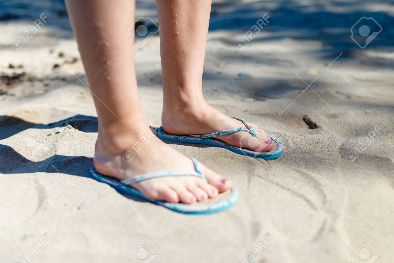 68a81efbe15d Feet Girl with a neat pedicure in women s stylish beach flip-flops aqua on  the