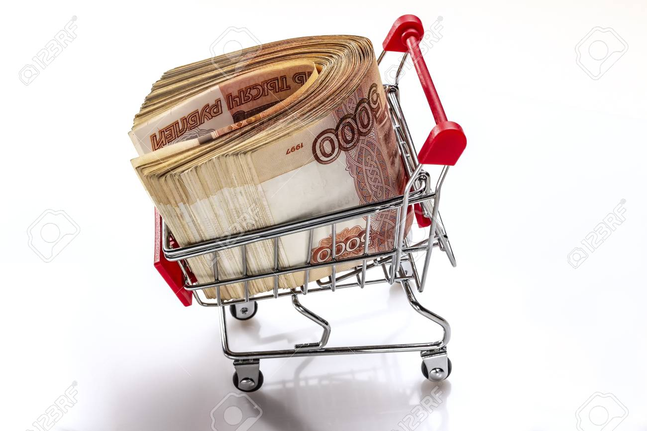 Truck with the money. A pack of Russian banknotes 5000 rubles. The money's in the supermarket cart. Creative financing. Banking service. In isolation.Creative financing. Banking service. - 109064311