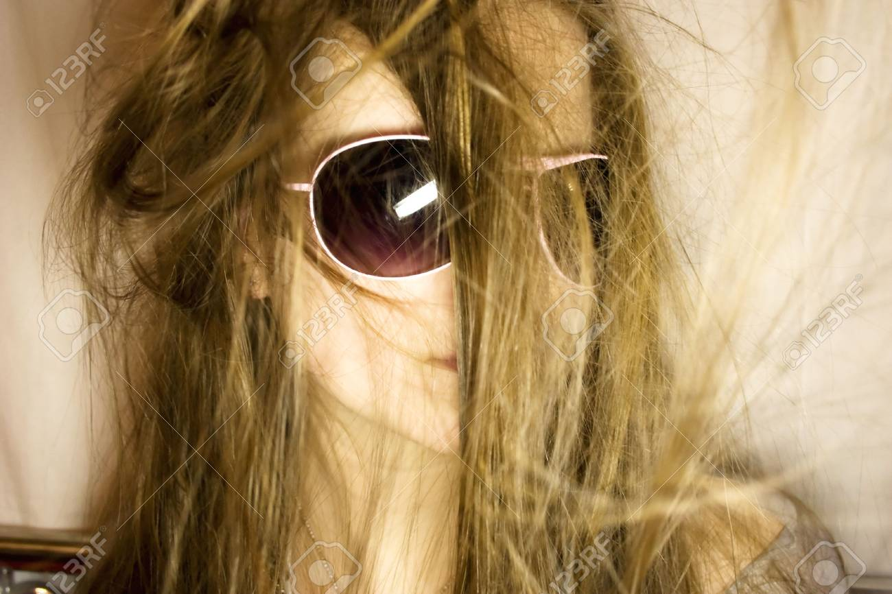 Portrait of the young woman in sunglasses Stock Photo - 4103200