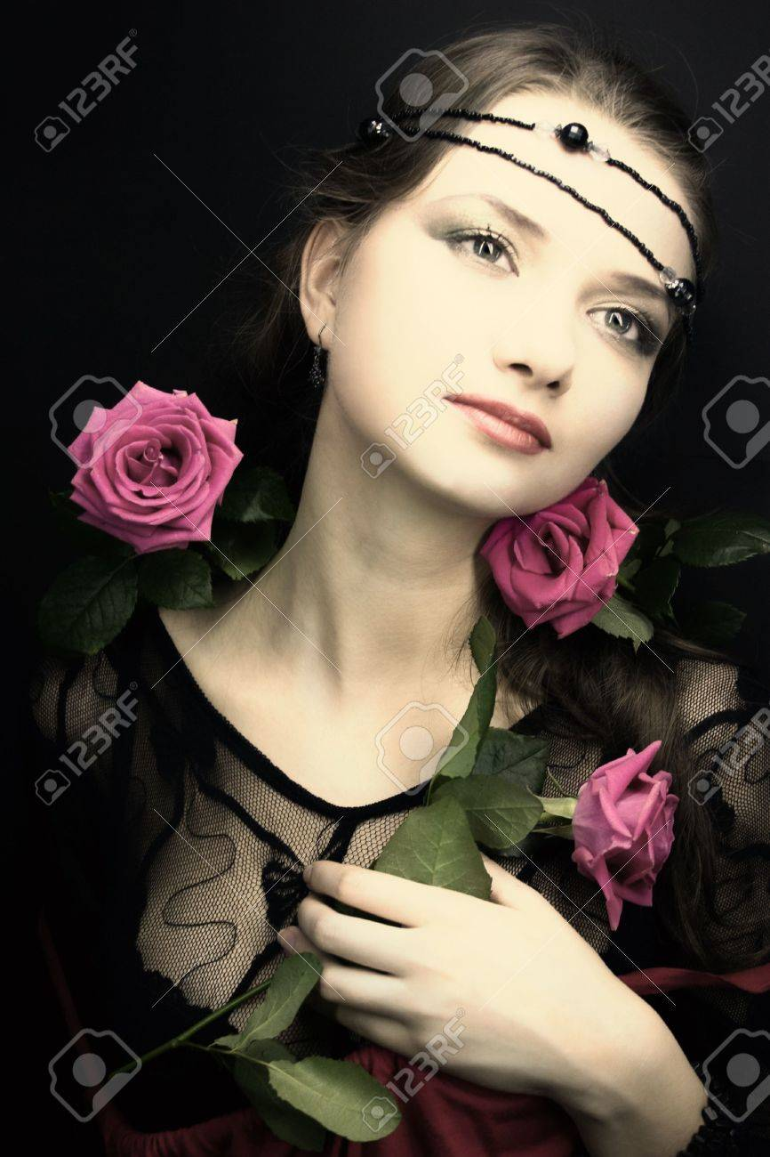 young woman with a rose. medieval style Stock Photo - 4700021