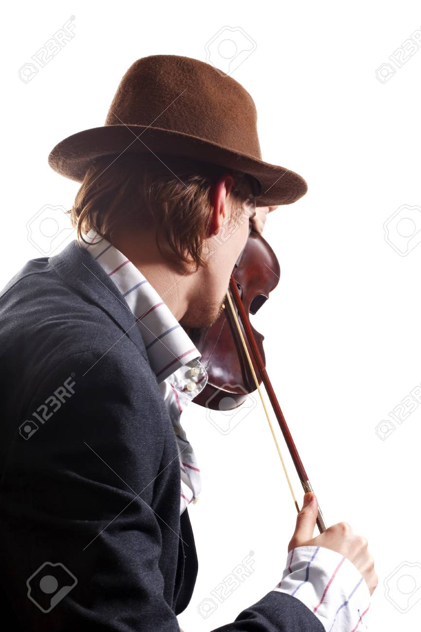 back of violinist playing the violin in hat and jacket on white background Stock Photo - 8366139