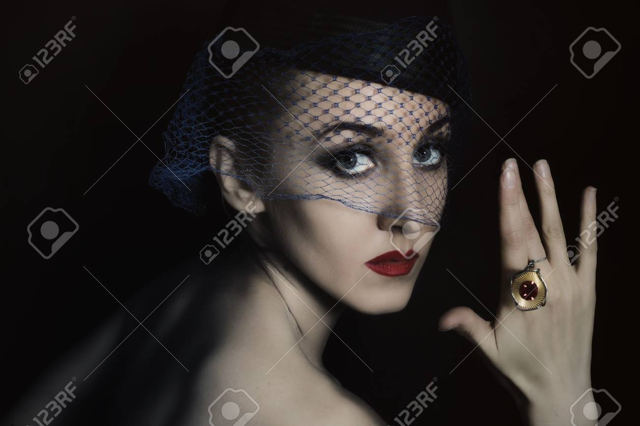 Retro portrait of beautiful young woman in  veil with  ring Stock Photo - 8712275