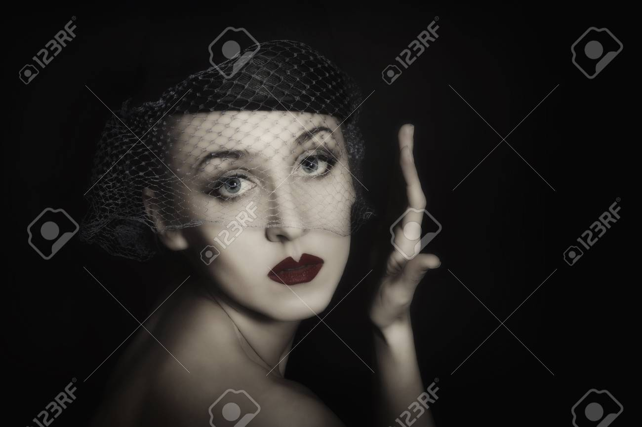 Retro portrait of beautiful young woman in veil Stock Photo - 8810500