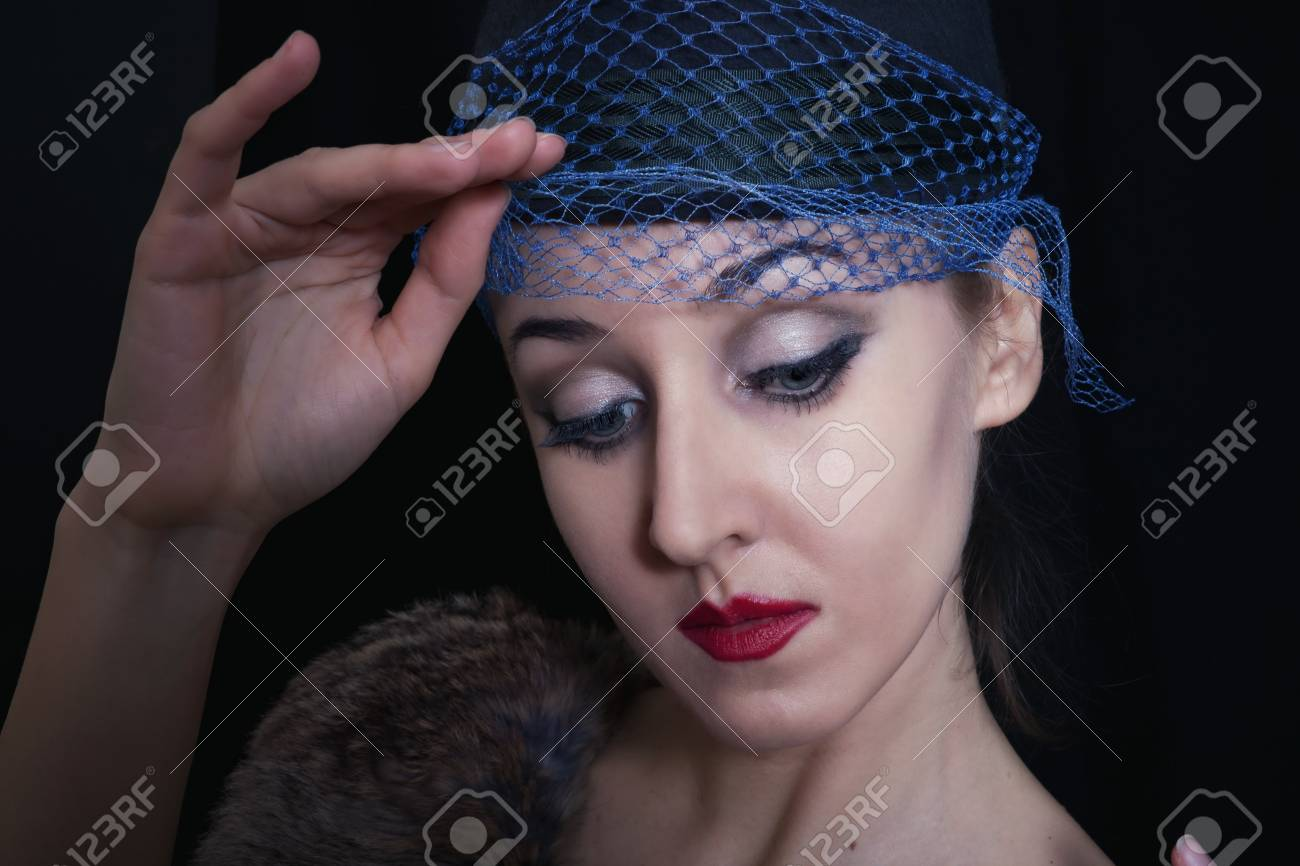 Portrait of young beautiful caucasian woman in veil on black background close up Stock Photo - 8810608