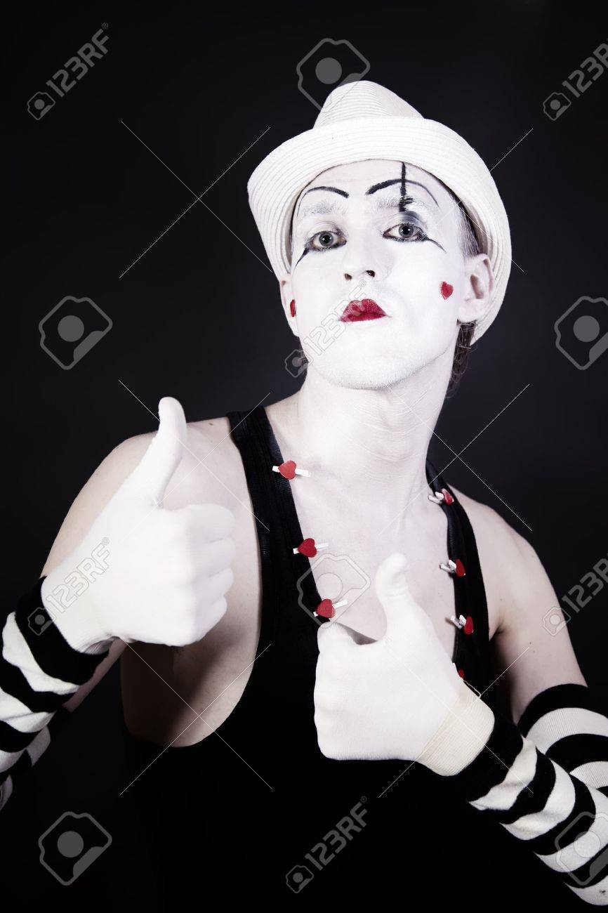 theater actor in makeup and a white hat on a black background Stock Photo - 10271397