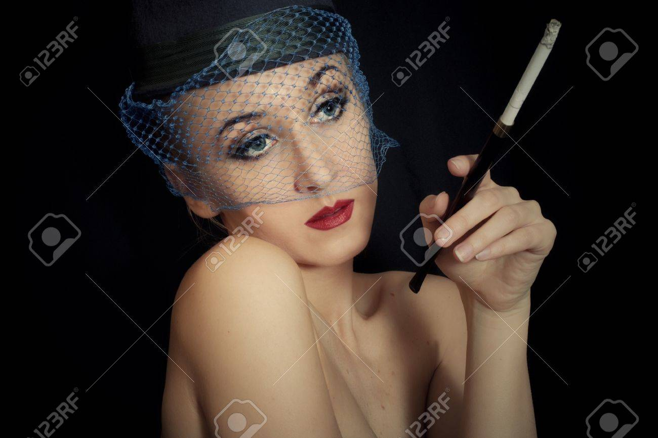 vintage Retro portrait of beautiful young caucasian woman in veil with cigarette closeup Stock Photo - 14728131
