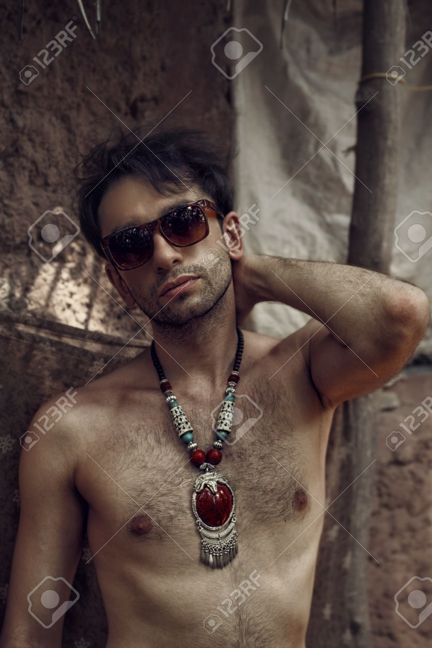 Portrait of young athletic naked men wearing a sunglasses Stock Photo -  65067550